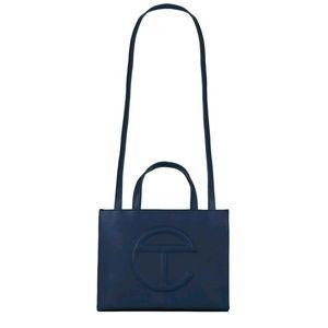 Lightly used medium navy blue Telfar tote